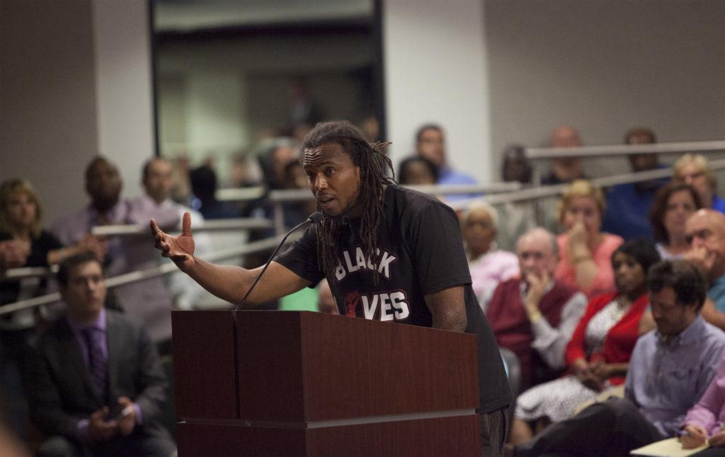 Muhiyidin Moye D'Baha of the Black Lives Matter movement, addresses the North Charleston city council demanding a citizen ...