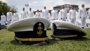 Graduates listen to closing remarks after tossing their caps in the air at the 134th Commencement Exercises of the United States Coast Guard Academy in New London, Connecticut in 2015. Photo by Kevin Lamarque/Reuters