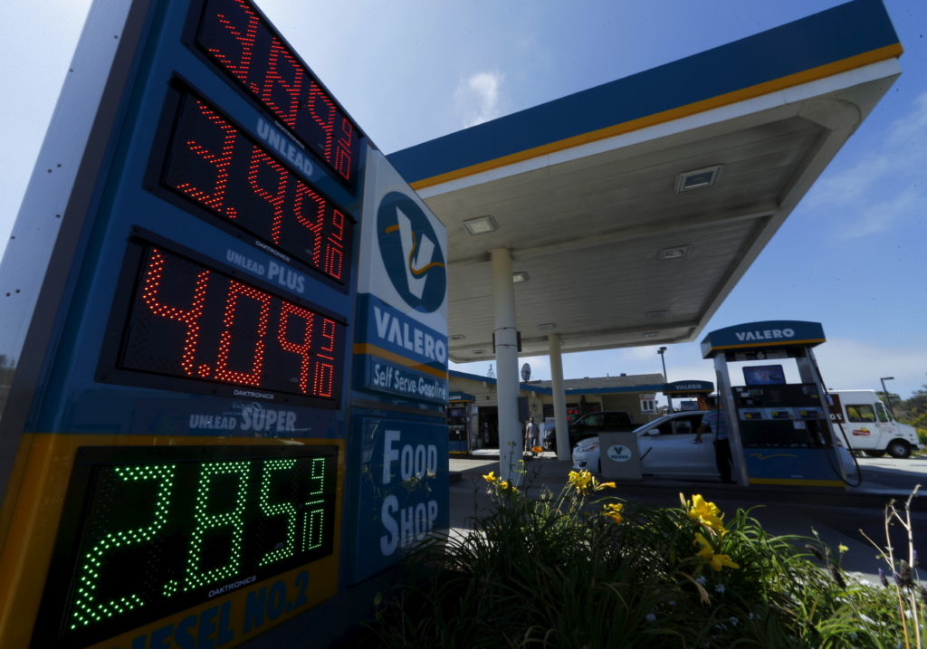 The current price of gasoline is shown on a gas station sign in Encinitas, California August 4, 2015. Brent, the world ben...