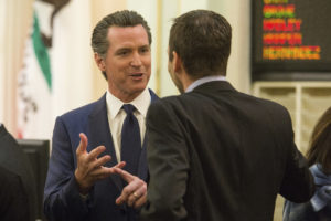 California Lt. Governor Gavin Newsom (L) talks to lawmakers before Gov. Jerry Brown's inauguration at the State Capitol in Sacramento, California, United States on January 5, 2015. Photo by: Max Whittaker/Reuters