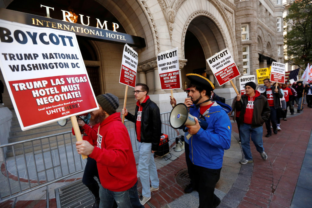 Representative of the AFL-CIO labor union protest against Republican U.S. presidential nominee Donald Trump on the sidewalk outside of the grand opening of his new Trump International Hotel in Washington, D.C. Even as labor unions have opposed Trump, many of their members support the president. October 26, 2016. Photo by Jonathan Ernst/Reuters
