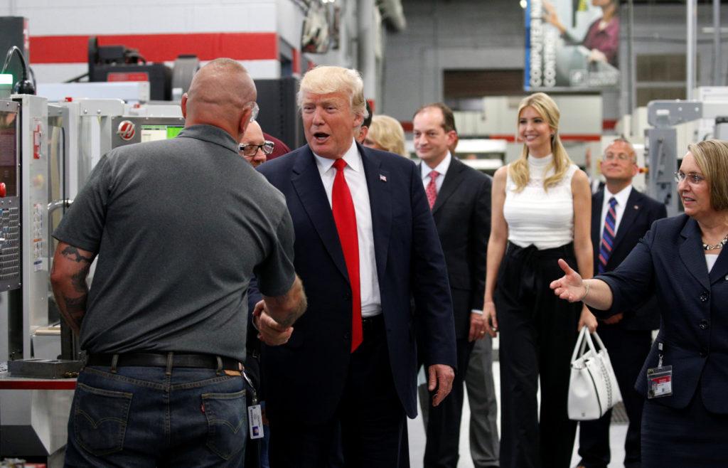 President Donald Trump shakes hands as he tours Waukesha County Tec…