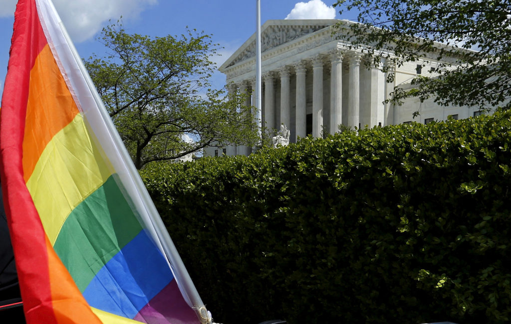 A rainbow colored flag is seen outside the U.S. Supreme Court in Washington. Photo by Jonathan Ernst/Reuters