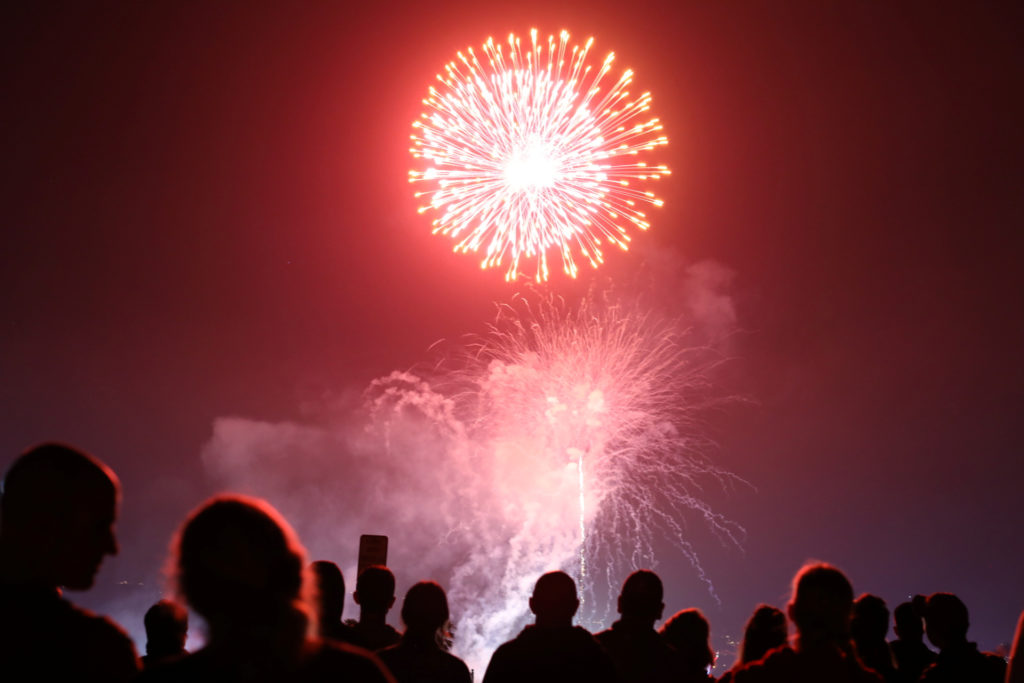 People watch fireworks over the Del Mar fair in celebration of the 241st anniversary of the Declaration of Independence, i...