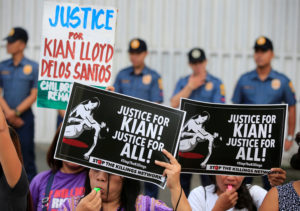 FILE PHOTO: Protesters hold placards seeking justice for 17-year-old high school student Kian delos Santos, who was killed in a recent police raid in an escalation of President Rodrigo Duterte's war on drugs, during a protest in front of the Philippine National Police (PNP) headquarters in Quezon city, Metro Manila, Philippines on August 23, 2017. Photo by Romeo Ranoco/Reuters