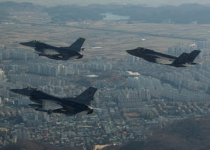 FILE PHOTO: A U.S. Air Force F-35A Lightning II assigned to Hill Air Force Base, Utah, conducts a training flight with F-16 Fighting Falcons assigned to Kunsan Air Base, South Korea over the city of Gunsan, in South Korea on December 1, 2017 in this U.S. Air Force photo and made available on December 5, 2017. Courtesy Josh Rosales/U.S. Air Force/Handout via Reuters