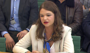 Brittany Kaiser, former Director of Program Development at Cambridge Analytica, speaks to Parliament's Digital, Culture Media and Sports committee in Westminster, London, Britain April 17, 2018. Parliament TV via Reuters