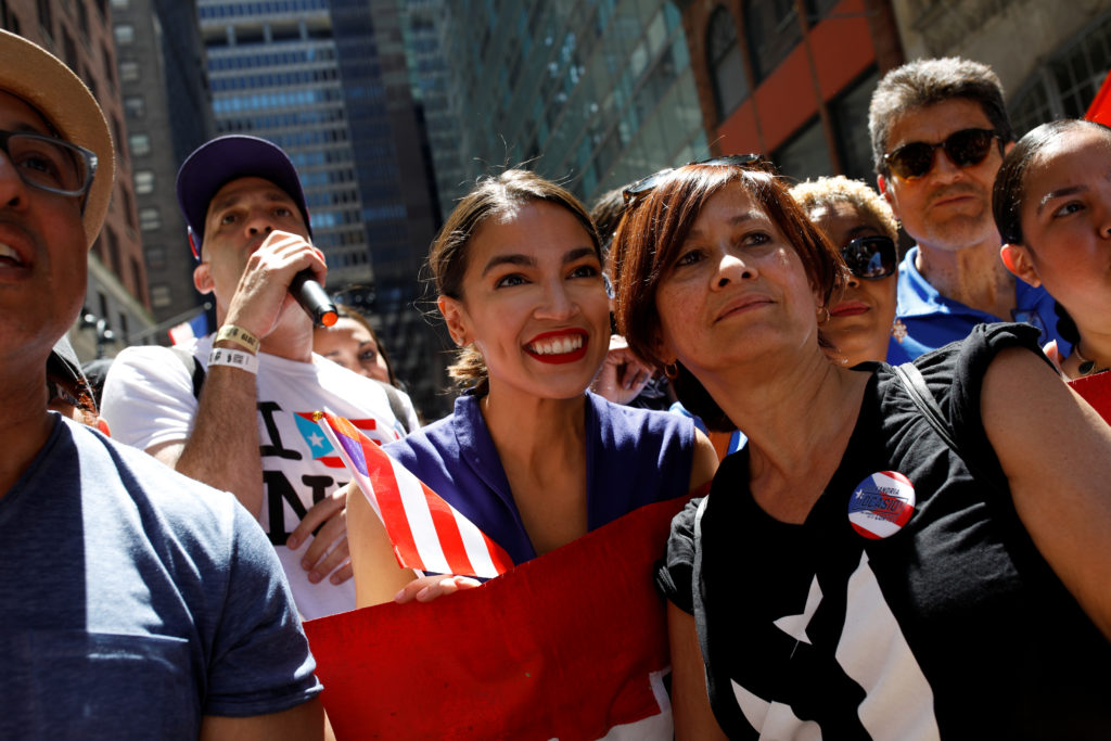 Representative Alexandria Ocasio-Cortez poses for a portrait with marchers at the annual Puerto Rican Day Parade in Manhat...