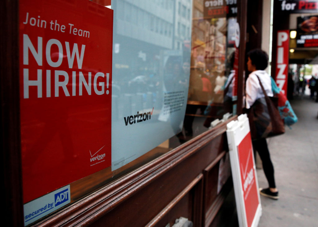 """FILE PHOTO: A """"Now Hiring"""" sign is posted on a Verizon store in Man…"""