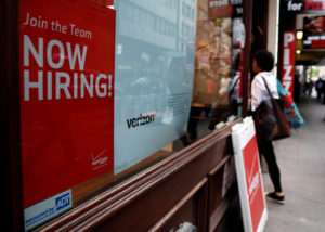 "FILE PHOTO: A ""Now Hiring"" sign is posted on a Verizon store in Manhattan in New York City, U.S. on May 10, 2016. Photo by Brendan McDermid/Reuters"