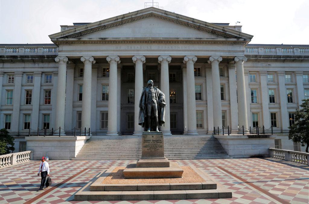 A man walks away from the U.S Treasury Department in Washington, U.…