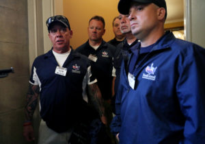 9/11 first responders, from left, John Feal, Kenny Specht, Matthew McCauley, Rich Palmer and Michael O'Connell speak with reporters after meeting with Senate Majority Leader Mitch McConnell (R-KY) about the reauthorization of the September 11th Victim Compensation Fund at the U.S. Capitol Building in Washington, U.S., June 25, 2019. Photo by: Leah Millis/Reuters