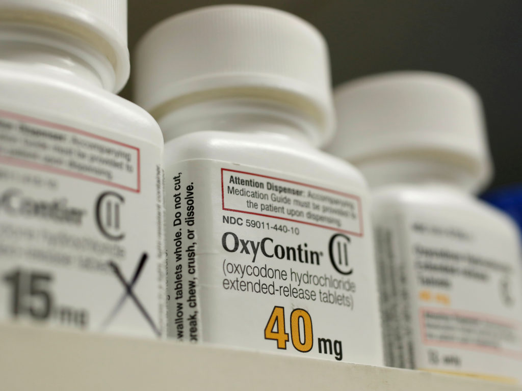 Bottles of prescription painkiller OxyContin made by Purdue Pharma LP sit on a shelf at a local pharmacy in Provo, Utah, U.S. April 25, 2017. Photo by: George Frey/Reuters