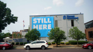 """A banner stating """"STILL HERE"""" hangs on the side of the Planned Parenthood Building after a judge granted a temporary restraining order on the closing of Missouri's sole remaining Planned Parenthood clinic in St. Louis, Missouri, U.S. May 31, 2019. Photo by: Lawrence Bryant/Reuters"""