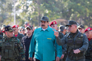 Venezuela's President Nicolas Maduro speaks with Venezuela's Defense Minister Vladimir Padrino Lopez and Remigio Ceballos Strategic Operational Commander of the Bolivarian National Armed Forces, during a military exercise in Valencia, Venezuela January 27, 2019. Photo courtesy: Miraflores Palace/Handout via Reuters