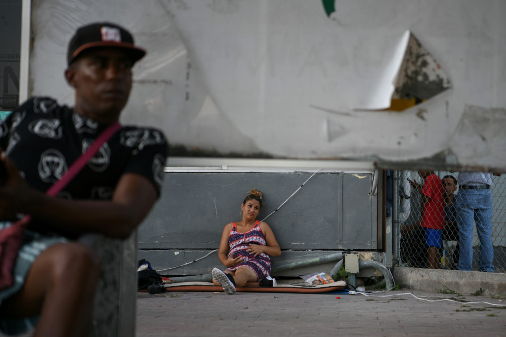 Pregnant Cuban asylum seeker Viviana Martinez waits in hopes of being let through the nearby U.S. port of entry at a makeshift migrant camp near the Gateway International Bridge in Matamoros, Tamaulipas, Mexico, on June 29, 2019. Photo by Loren Elliott/Reuters