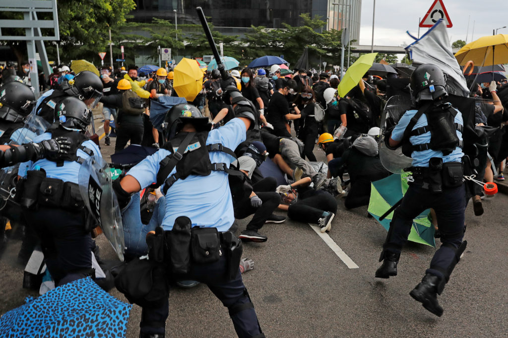 Riot police try to disperse protesters on the anniversary of Hong Kong's handover to China in Hong Kong. Photo by Tyrone Siu/Reuters
