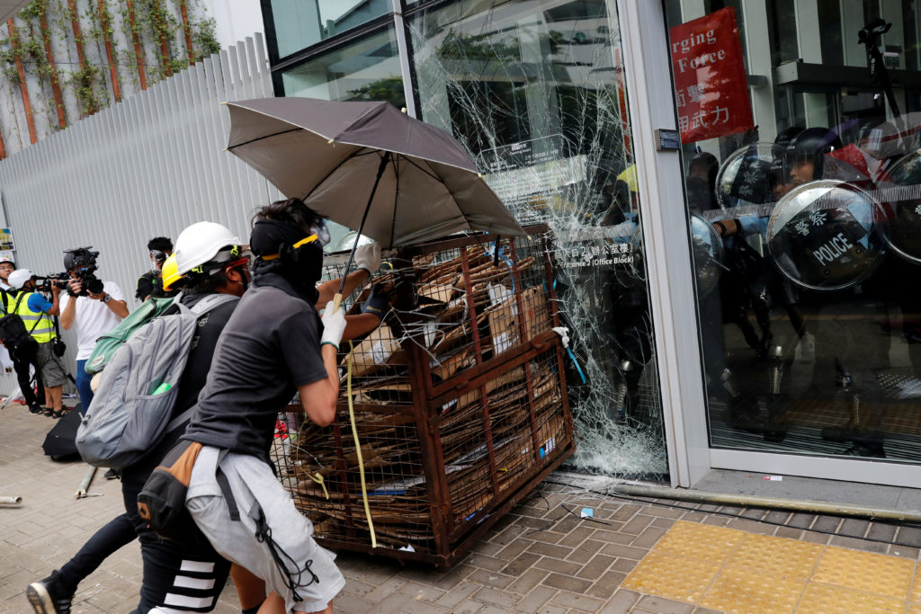 Protesters try to break into the Legislative Council building where riot police are seen, during the anniversary of Hong Kong's handover to China in Hong Kong on July 1, 2019.  Photo by Tyrone Siu/Reuters