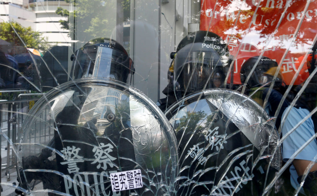 Riot police is seen inside the Legislative Council building where protesters try to break into, during the anniversary of Hong Kong's handover to China in Hong Kong on July 1, 2019. Photo by Thomas Peter/Reuters
