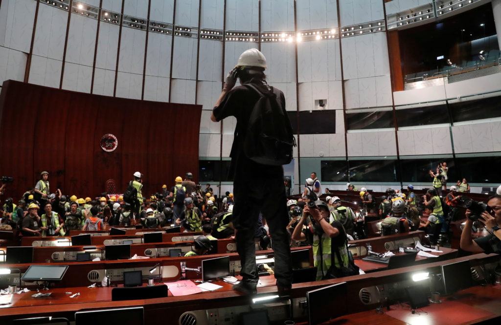 Protesters are seen inside a chamber after they broke into the Legi…