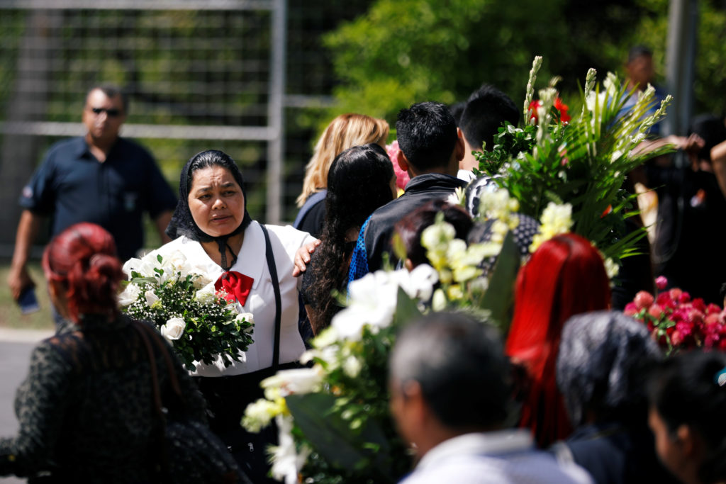 Family and friends participate in the funeral of Oscar Alberto Martinez Ramirez and his daughter Valeria, migrants who drowned in the Rio Grande river during their journey to the U.S., at La Bermeja cemetery in San Salvador, El Salvador July 1, 2019. Photo by Jose Cabezas/Reuters