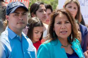 U.S. Representative Veronica Escobar (right) from El Paso speaks to the news media along with Rep. Joaquin Castro (left) and Rep. Alexandria Ocasio-Cortez (center) after they toured two Border patrol stations following reports of migrants kept in inadequate condtions, in Clint, Texas, on July 1, 2019. Photo by Julio-Cesar Chavez/Reuters