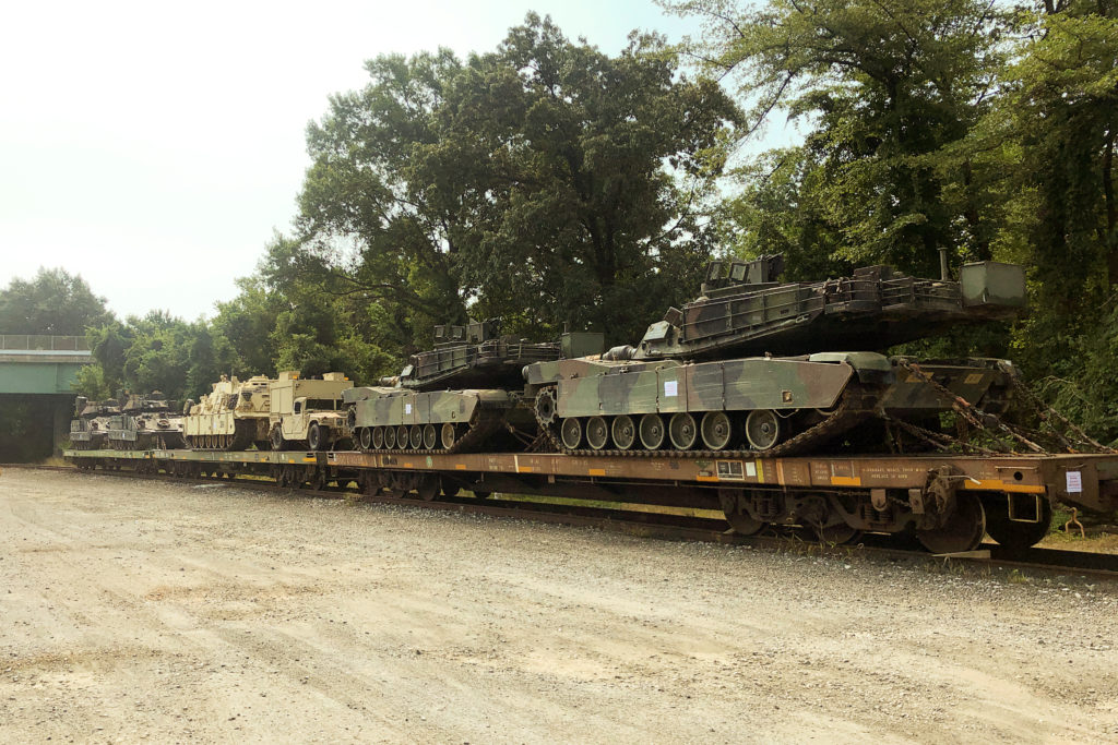 M1 Abrams tanks and other armored vehicles sit atop flat cars in a rail yard after U.S. President Donald Trump said tanks and other military hardware would be part of Fourth of July displays in Washington, on July 2, 2019. Photo by Kevin Fogarty/Reuters