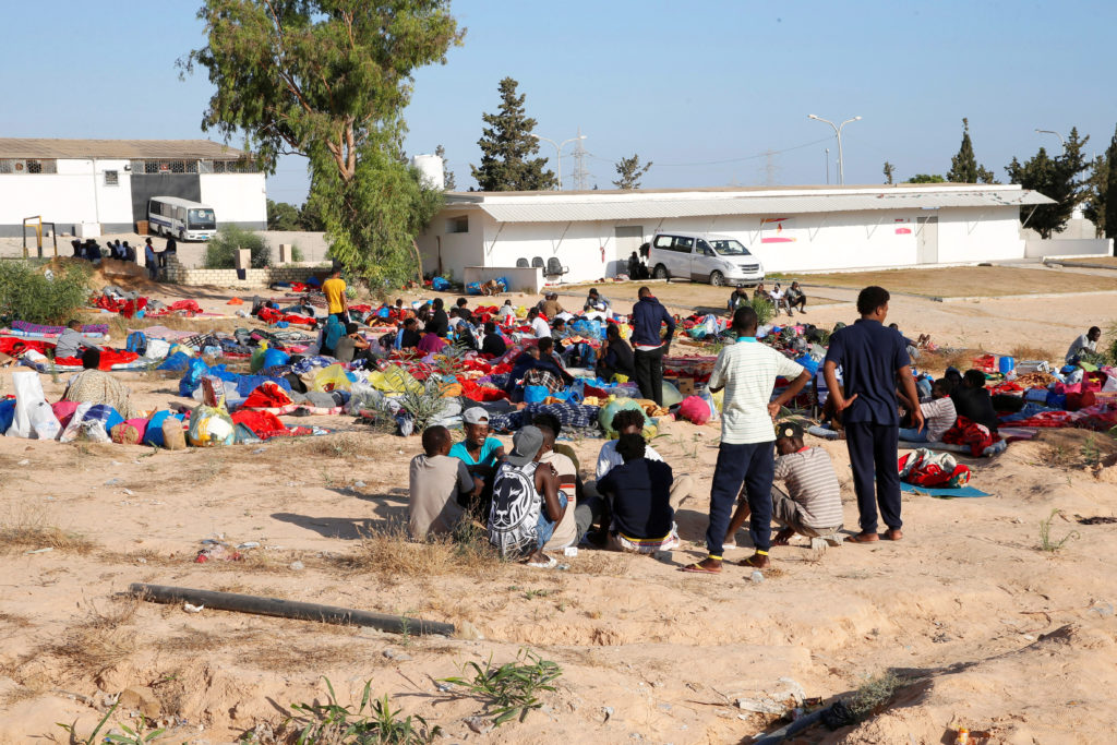 Migrants are seen with their belongings at the yard of a detention centre for mainly African migrants, hit by an airstrike, in the Tajoura suburb of Tripoli, Libya on July 3, 2019. Photo by Ismail Zitouny/Reuters