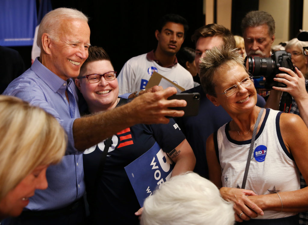 Democratic 2020 U.S. presidential candidate and former Vice President Joe Biden takes photos with supporters at a campaign event in Marshalltown, Iowa, on July 4, 2019. Photo by Brenna Norman/Reuters