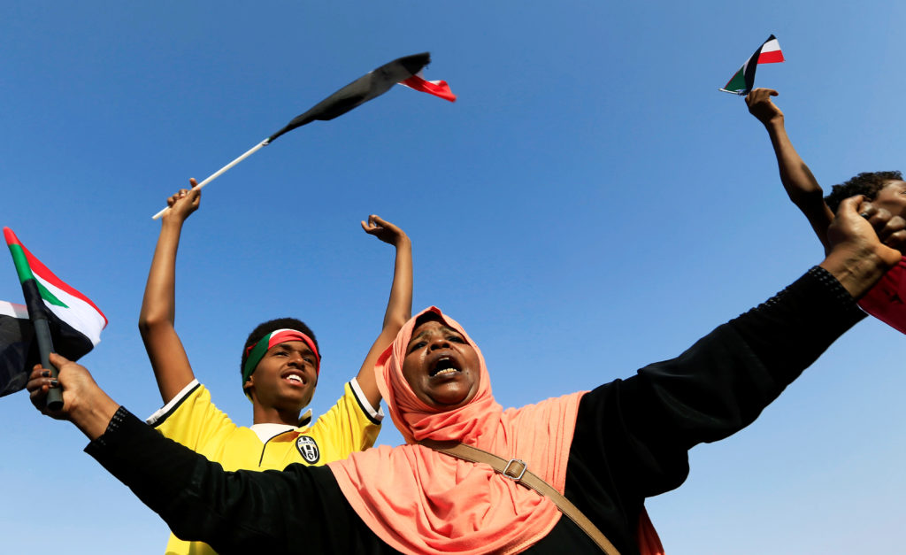 A Sudanese woman chants slogans and wave national flag in celebration, following Sudan's ruling military council and a coalition of opposition and protest groups reached an agreement to share power during a transition period leading to elections, along the streets of Khartoum, Sudan, July 5, 2019. Photo by Mohamed Nureldin Abdallah/Reuters