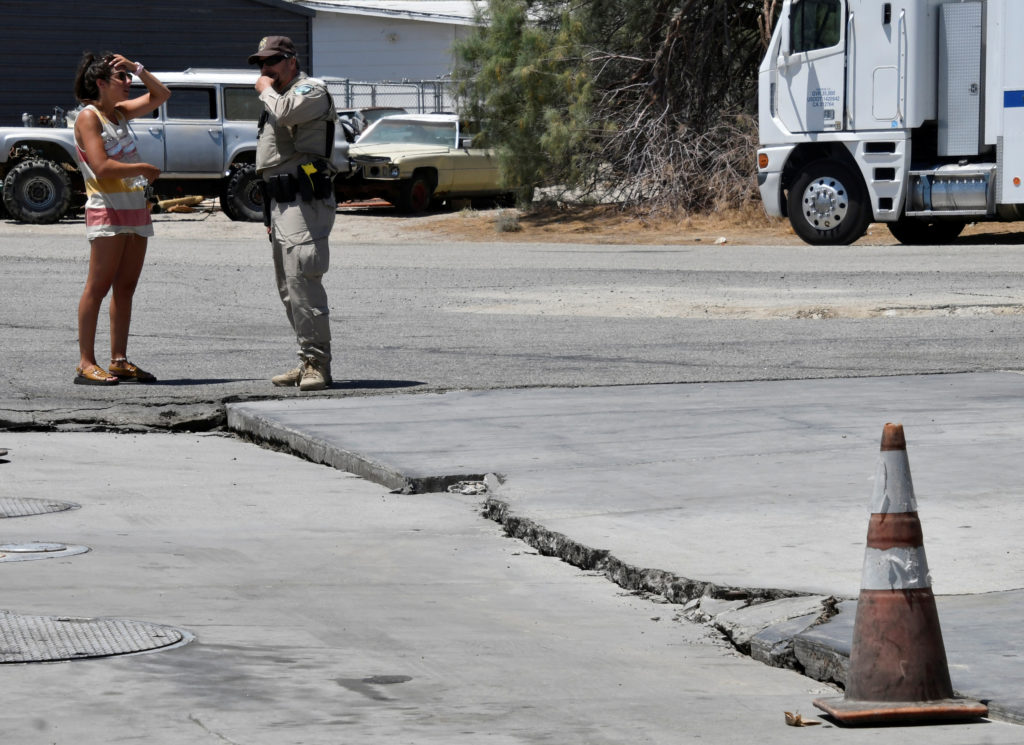 One of several surface cracks is seen in a road after an earthquake near Trona, California, on July 6, 2019. Photo by Gene Blevins/Reuters