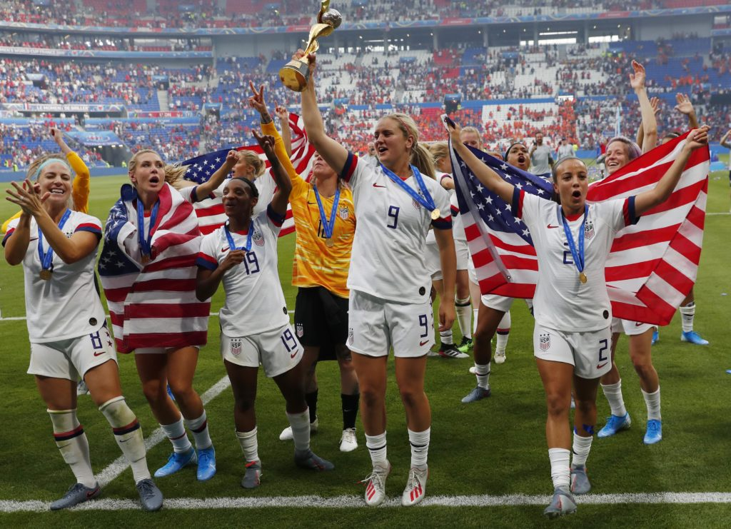 United States midfielder Lindsey Horan (9) hoists the World Cup trophy and celebrates with teammates after defeating the Netherlands in the championship match of the FIFA Women's World Cup France 2019 at Stade de Lyon. The final match brought in more than 14 million viewers. Photo by Michael Chow-USA TODAY Sports