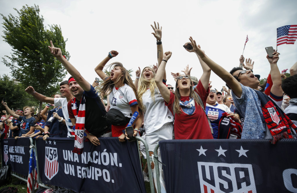 Fans celebrate  a United States goal against Netherlands during a watch party for the FIFA Women's World Cup final match at Lincoln Park. By drawing in more fans, the U.S. women's team says it has generated more revenue for U.S. Soccer. Photo by Kamil Krzaczynski-USA TODAY Sports