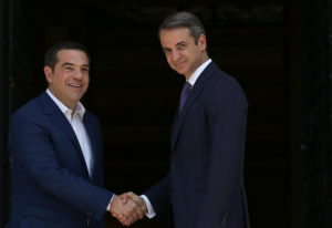 Newly-appointed Greek Prime Minister Kyriakos Mitsotakis shakes hands with outgoing Prime Minister Alexis Tsipras at the Maximos Mansion in Athens, Greece July 8, 2019. Photo by Costas Baltas/Reuters