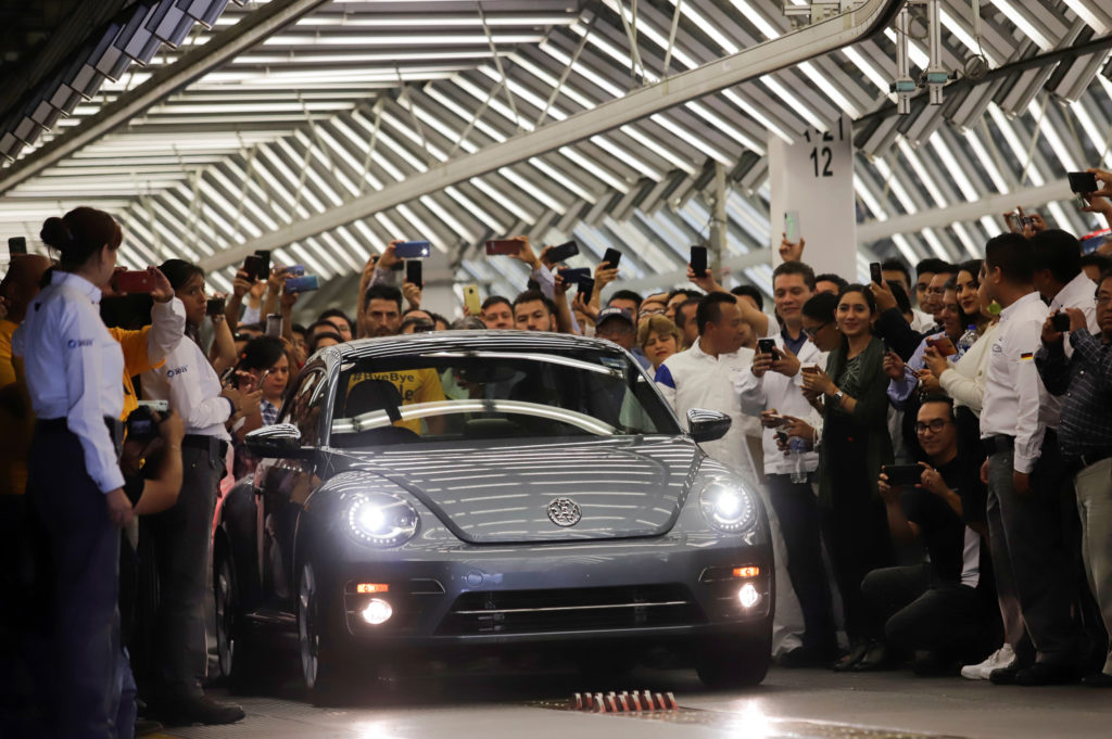 Employees take pictures of a Volkswagen Beetle car during a ceremony marking the end of production of VW Beetle cars, at company's assembly plant in Puebla, Mexico, July 10, 2019. Photo by: Imelda Medina/Reuters
