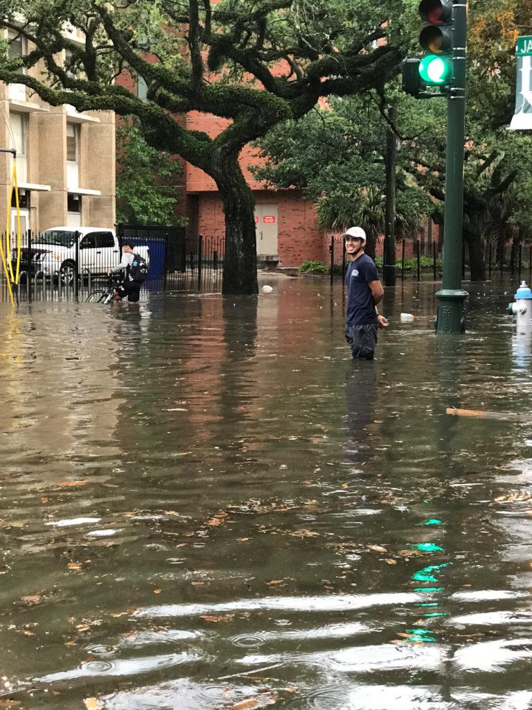 A pedestrian stands in a flooded street near Tulane University in New Orleans, Louisiana, U.S., July 10, 2019. Photo by: Merisa Pasternak/Reuters