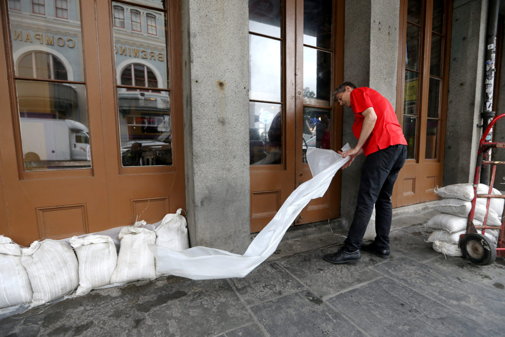 An employee places sandbags in front of a business in the French Quarter as Tropical Storm Barry approaches land in New Orleans, Louisiana, U.S. July 12, 2019. Photo by: Jonathan Bachman/Reuters