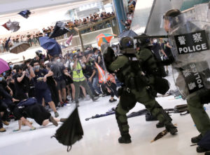 Riot police use pepper spray to disperse pro-democracy activists inside a mall after a march at Sha Tin District of East New Territories, Hong Kong, China on July 14, 2019. Photo by Tyrone Siu/Reuters