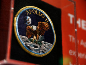 "An Apollo 11 mission patch is seen on the anniversary of the Apollo 11 mission launch at the ""Destination Moon: The Apollo 11 Mission"" exhibit at the Museum of Flight in Seattle, Washington. Photo by Lindsey Wasson/Reuters"