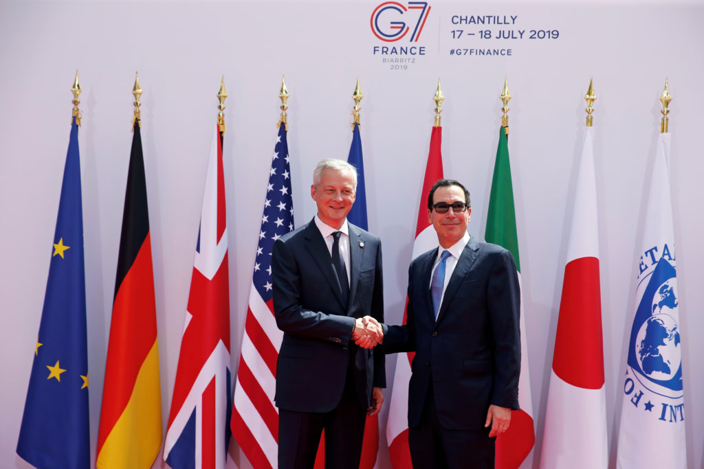 French Finance Minister Bruno Le Maire welcomes U.S. Treasury Secretary Steven Mnuchin at the G7 finance ministers and central bank governors meeting in Chantilly, near Paris, France, on July 17, 2019. Photo by Pascal Rossignol/Reuters