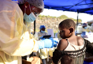 A Congolese health worker administers ebola vaccine to a child at the Himbi Health Centre in Goma, Democratic Republic of Congo, on July 17, 2019. Photo by Olivia Acland/Reuters