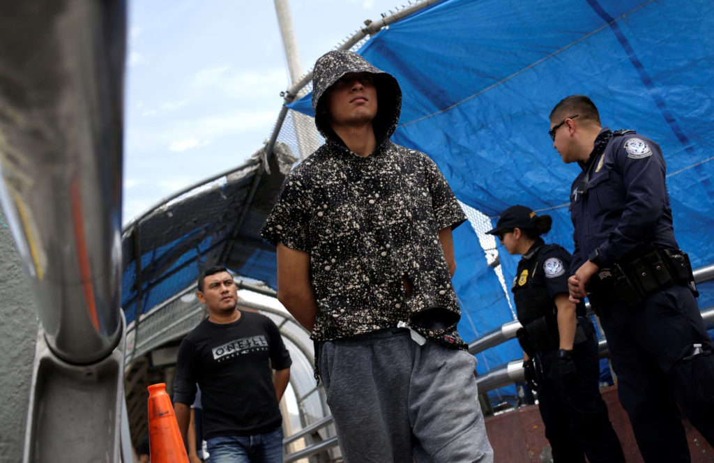 Mexican migrants deported from the U.S. walk towards Mexico at Paso del Norte International border bridge, in this picture...