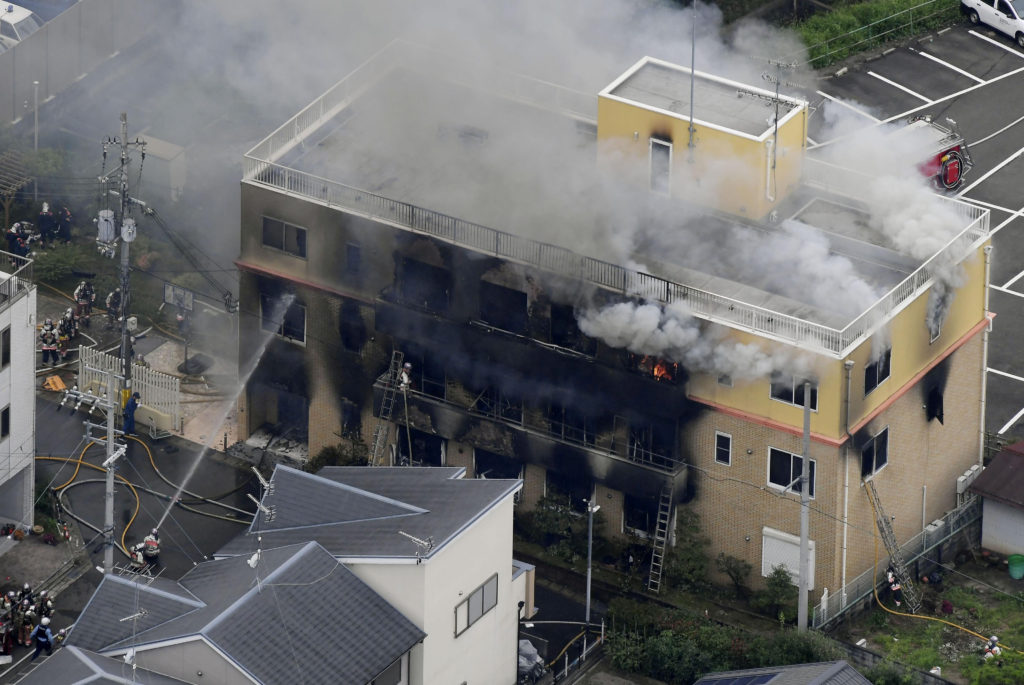 An aerial view shows firefighters battling fires at the site where a man started a fire after spraying a liquid at a three-story studio of Kyoto Animation Co. in Kyoto, western Japan, in this photo taken by Kyodo, on July 18, 2019. Photo by Kyodo/via Reuters