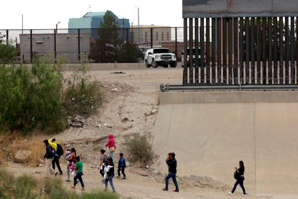 Migrants are seen after crossing illegally into El Paso, Texas, U.S…