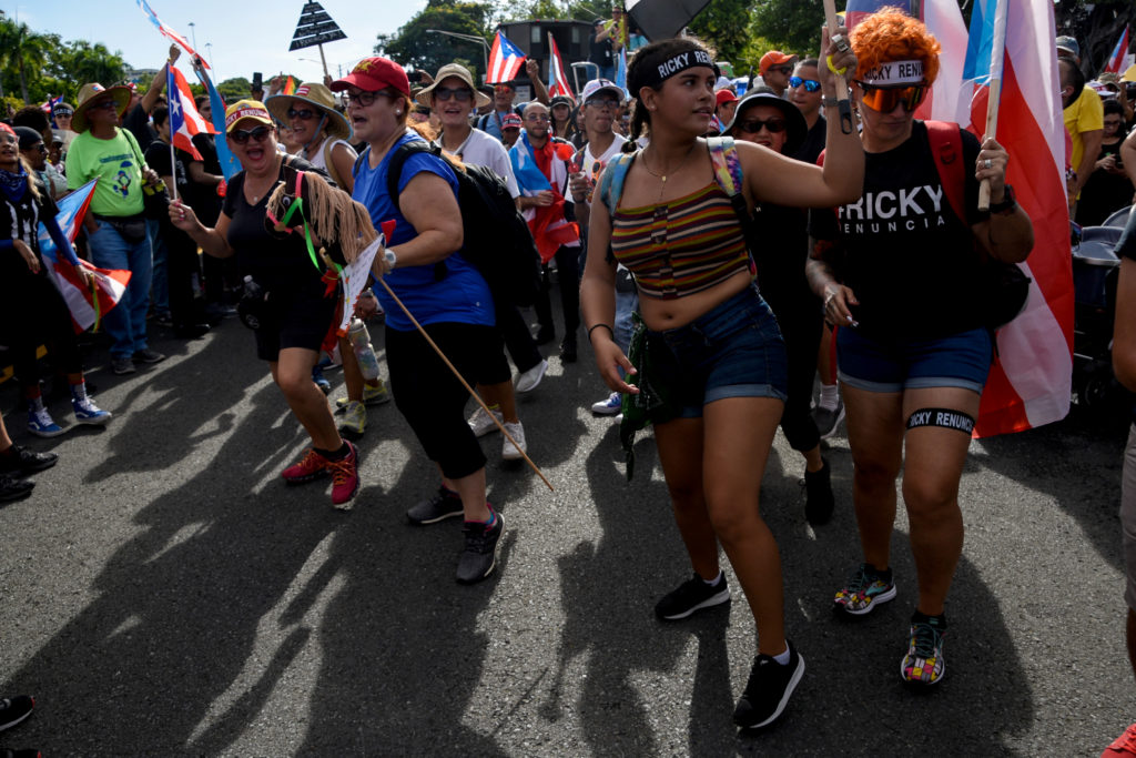 Demonstrators chant and wave Puerto Rican flags during the national strike calling for the resignation of Governor Ricardo Rossello, in San Juan, Puerto Rico July 22, 2019. Photo by: Gabriella N. Baez