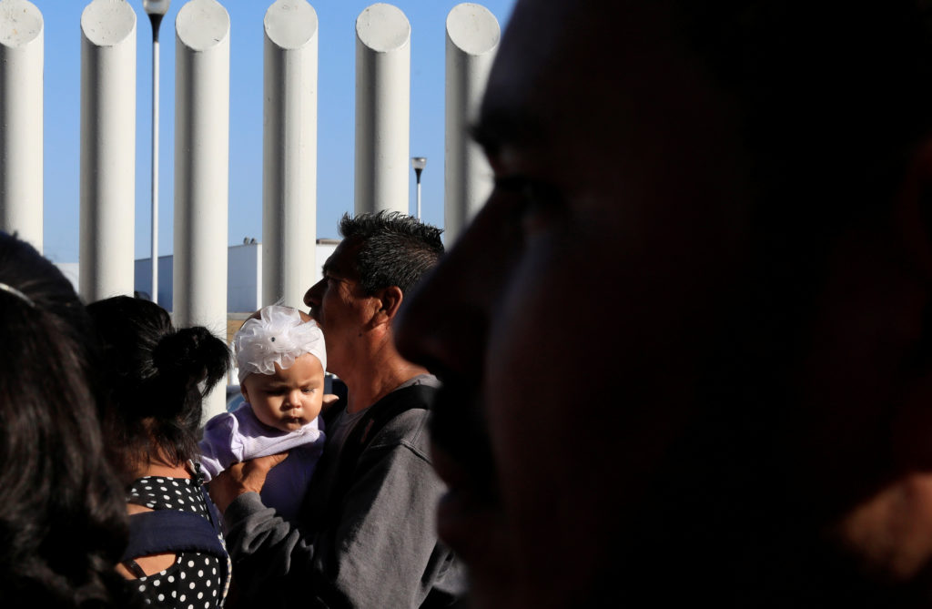 Migrants wait to apply for asylum in the United States outside the El Chaparral border in Tijuana, Mexico July 24, 2019. Photo by: Carlos Jasso/Reuters
