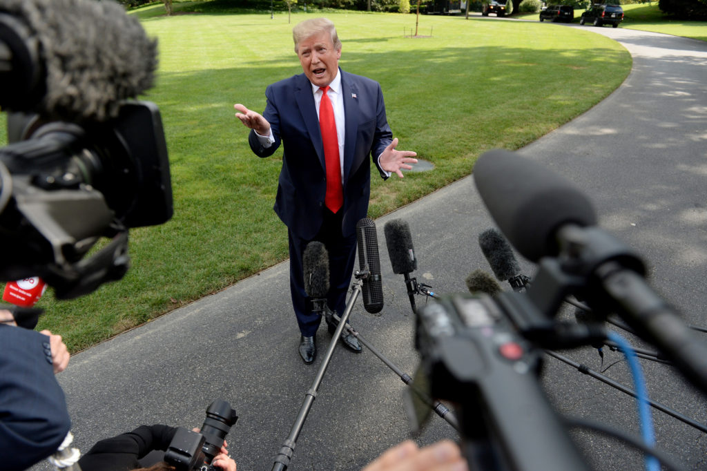 U.S. President Donald Trump speaks to the media before departing the White House en route West Virginia in Washington, U.S., July 24, 2019. Photo by: Mary F. Calvert/Reuters