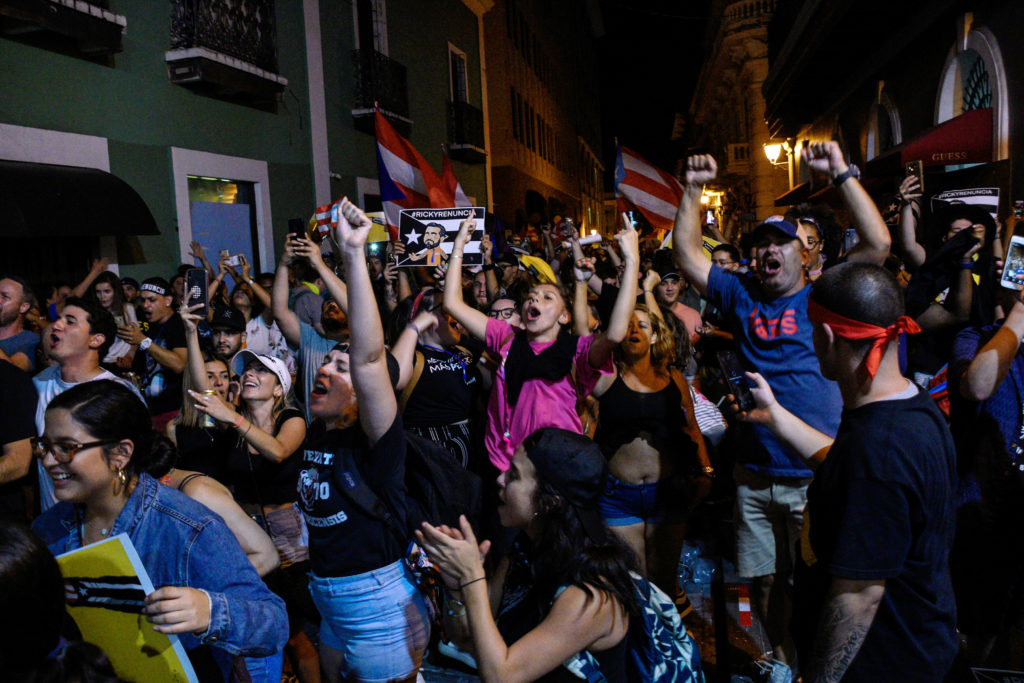 Demonstrators celebrate after the resignation of Puerto Rico Governor Ricardo Rossello in San Juan, Puerto Rico, on July 24, 2019. Photo by Gabriella N. Baez/Reuters