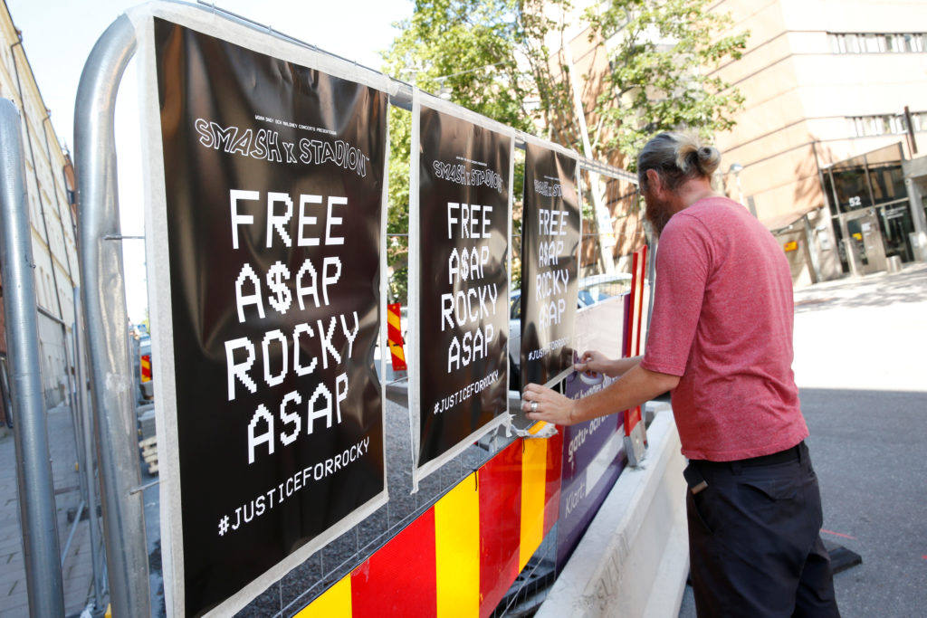 A man puts up posters outside the Kronoberg custody, as a prosecution for assault and battery was announced against U.S. rapper ASAP Rocky in Stockholm, Sweden July 25, 2019. Photo by Fredrik Persson/TT News Agency/via Reuters