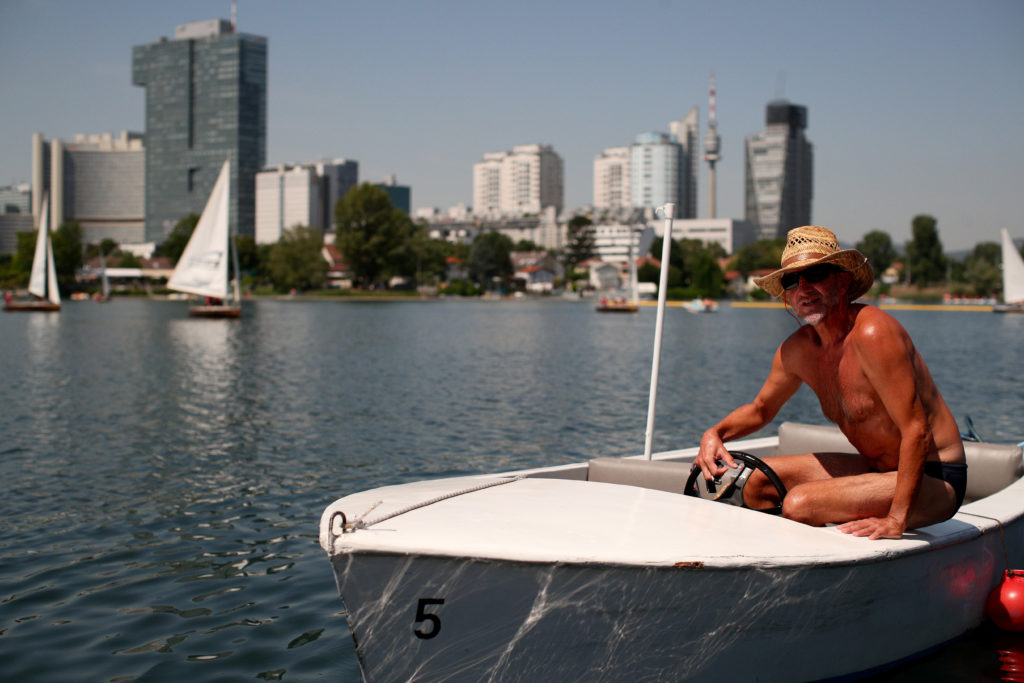 A man steers a boat at Alte Donau, an abandoned meander of river Da…